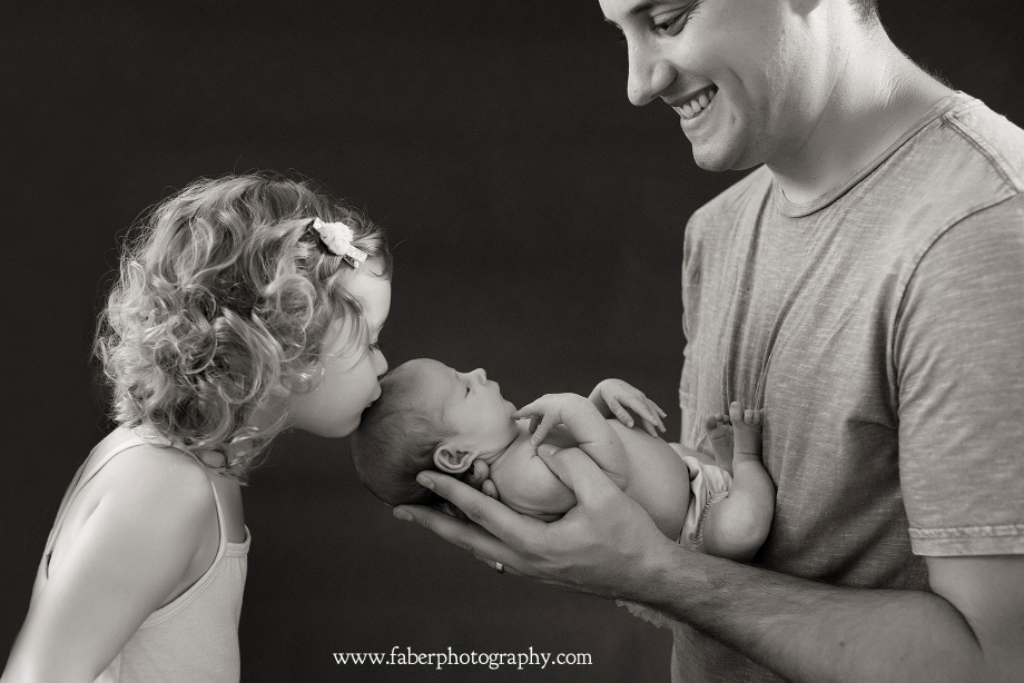 Sibling Kissing Photo Wisconsin Newborn Photography Studio
